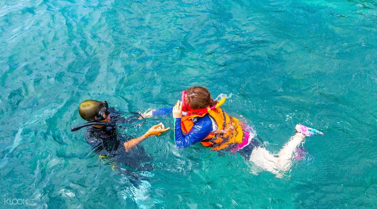 divers at racha yai phuket coral island tour